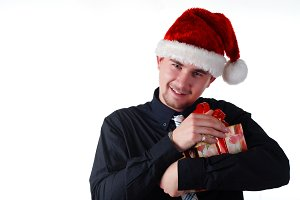 man in christmas hat with present