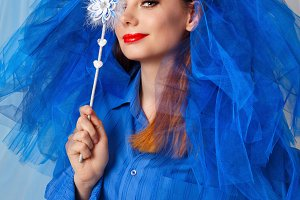 Bride in blue dress with magic wand