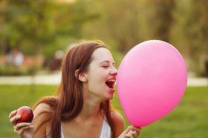 Girl, an apple and a balloon