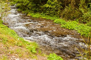 The river is flowing downstream