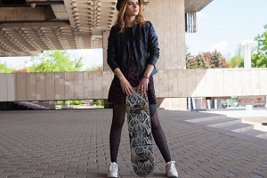 girl touching the skateboard