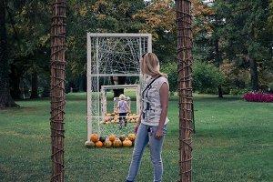 Woman,child and autumn pumpkins