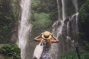 Female tourist admiring waterfall