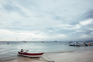 Beautiful beach with small boat