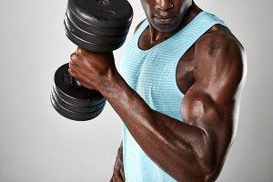 Muscular man doing biceps curl