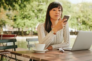 Attractive woman using smartphone