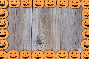 Halloween pumpkin border on wood