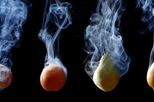 set of fruits enveloped by smoke