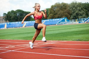 woman in a sports suit running