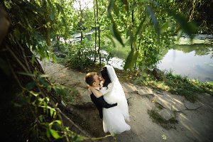 Beautiful wedding couple hugging in the park
