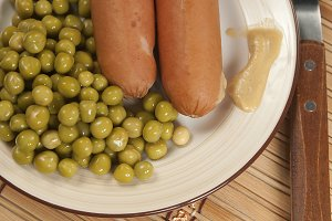Sausages with green peas