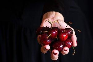 sweet fruit in woman hand