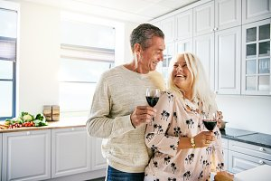 Vivacious healthy elderly couple drinking wine