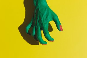 green hand of dead zombie