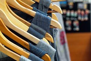 Several linen dresses on hangers