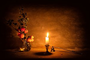 Apples and candle