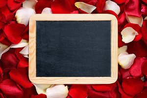 Blackboard on rose petals