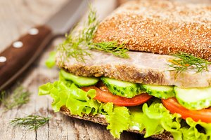 Sandwich with roast meat and veggies