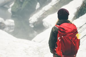 Traveler with backpack hiking alone