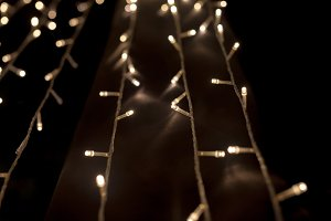 Christmas light chain along the way in the dark