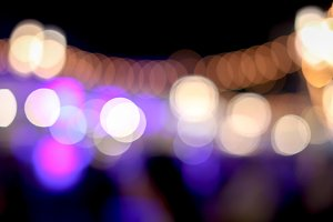 De-focused night street market in blurry background