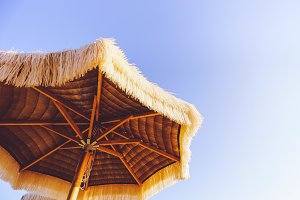 Beach umbrella on clean blue sky