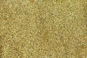 Shining gold glitter detailed texture for background (Selective focus)