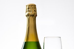 Champagne bottle with a glass cup