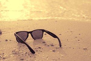black sunglasses and sea background