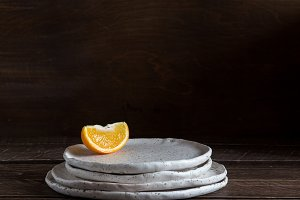 orange slice on ceramic plates