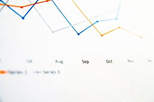 Business graph on white paper