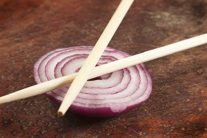 Still life with chopsticks and onion