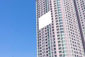 blank billboard on building in city