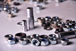 screws, bolts, nails, dowels, rivets, nuts, background
