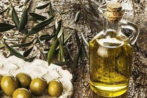 olive oil jar and olives