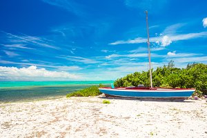 Old fishing boat on a tropical beach at the Caribbean