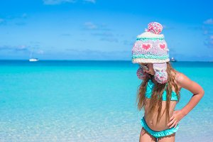 Adorable happy little girl having fun on tropical beach