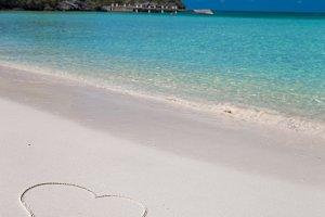Love written on tropical beach white sand