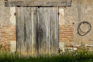Barn door in brick & stone wall