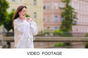 Young girl talking by phone outdoor