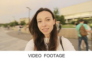 Young girl making video selfie