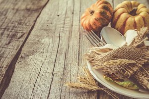 Thanksgiving decorations on rustic background