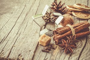 Selection of christmas spices on rustic wood background