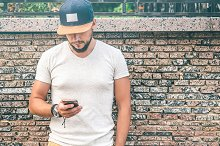 Young bearded Man using Smartphone