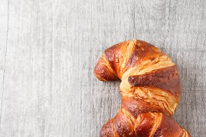 French food for breakfast. Fresh baked croissants. Light wood background. Top view