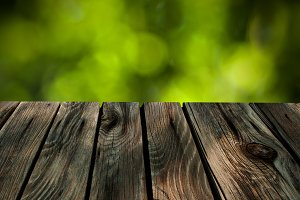 Wood Floor On Green Bokeh Background