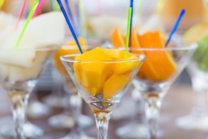 Fresh fruit cuts in martini glasses party