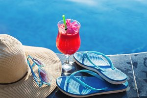 Watermelon fresh juice smoothie drink with flower, sunglasses slippers