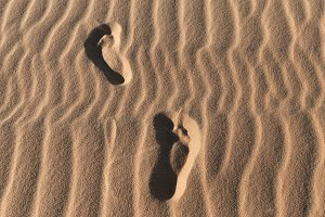 Footprints on a sand dunes desert
