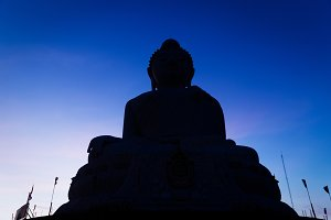 Big marble buddha statue sunset light on Phuket island, Thailand